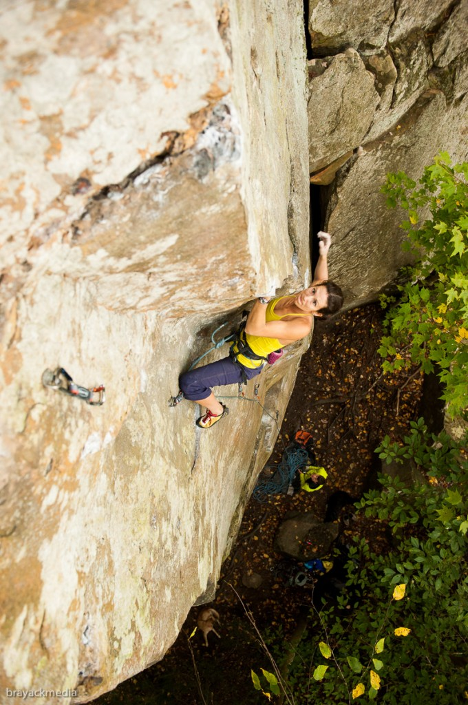 A belayer receives extra points for color-coordinating with their climber...