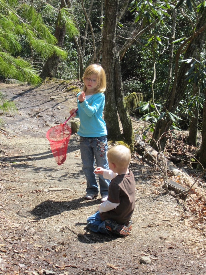 Addie and her brother exploring together on the trail