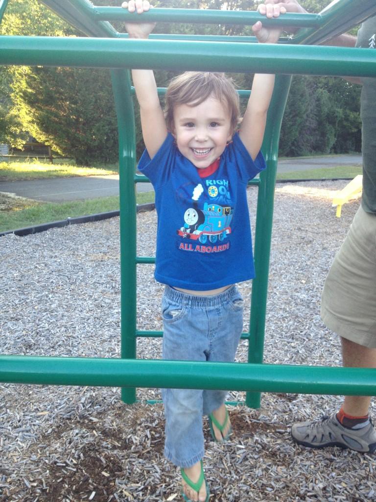 A sweet little monkey mid-swing