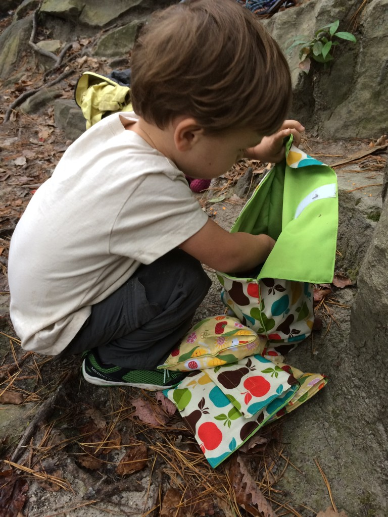 C digging through our homemade collection of bags to find the perfect crag snack!