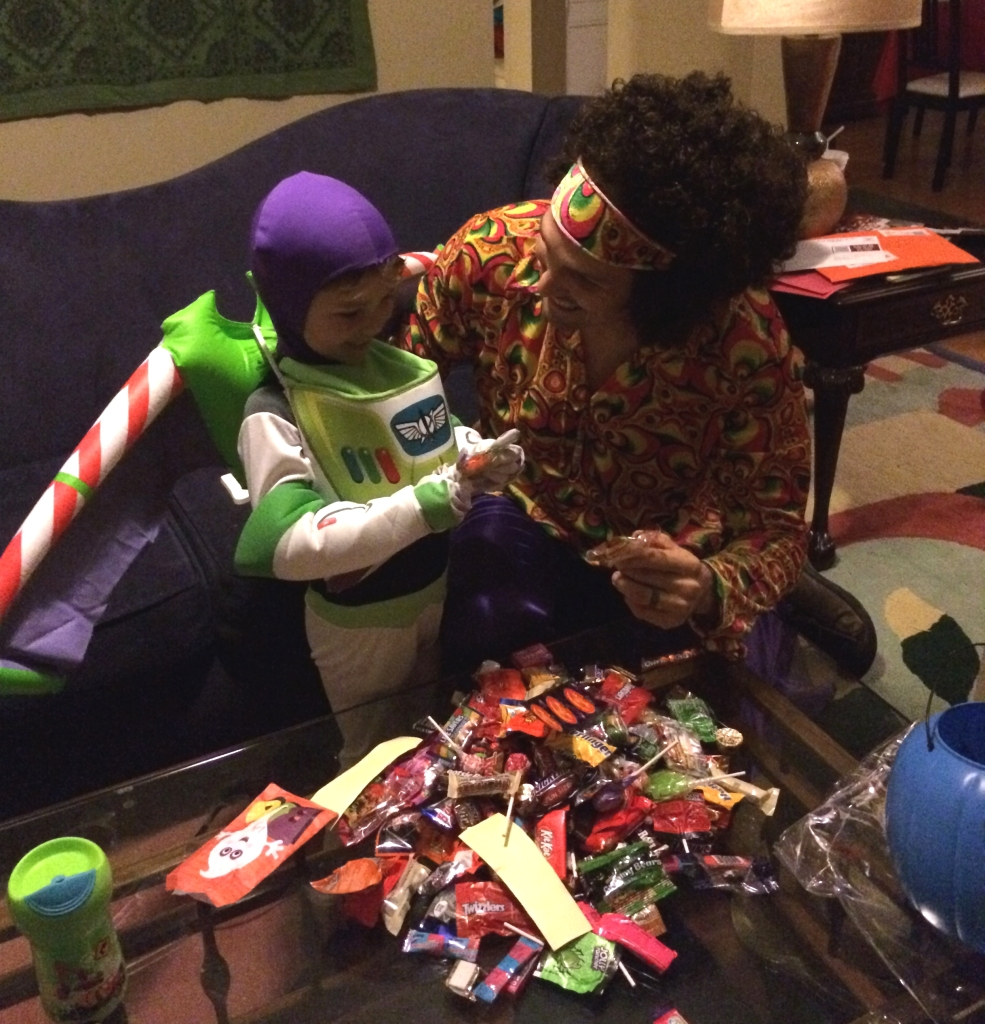 Buzz Lightyear and Jimi Hendrix analyzing their spoils.