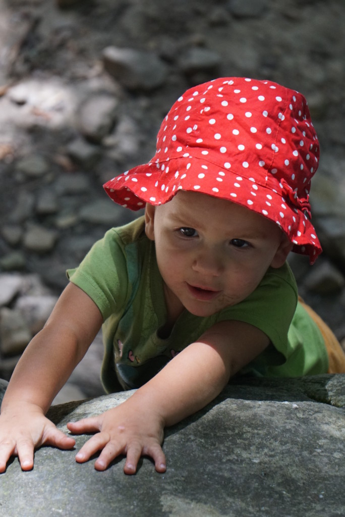 Baby Zu focused on a boulder problem at the base...