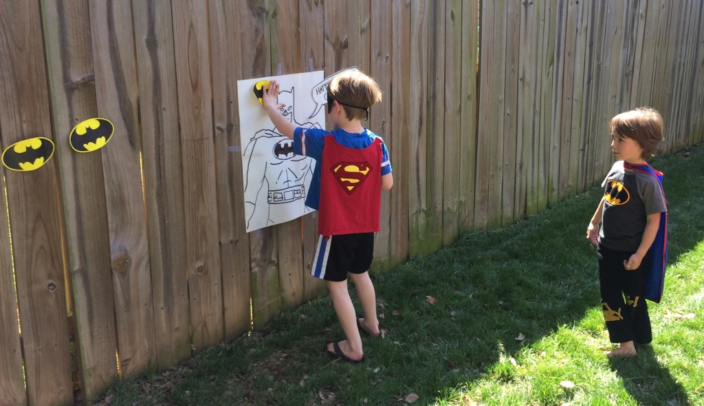 "Superman taking a turn at ""Pin the Bat on the Batman"""