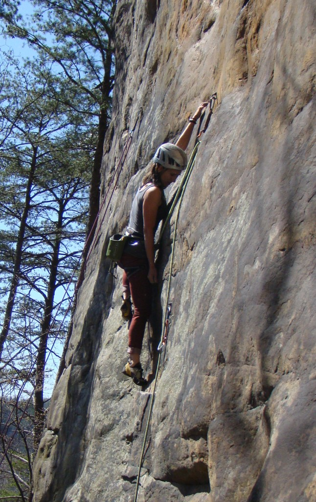 Stretching tall on Techman 5.12c at the New River Gorge
