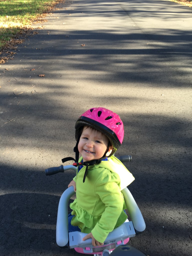 Styling in the Tricycoo with her Joovy Noodle Helmet.