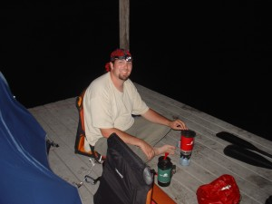 Steve cooking ramen noodles by moonlight (and headlamp) on our chickee in the middle of the Everglades.