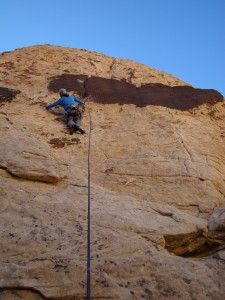 Steve preparing for the crux on Trigger Happy (5.10a)